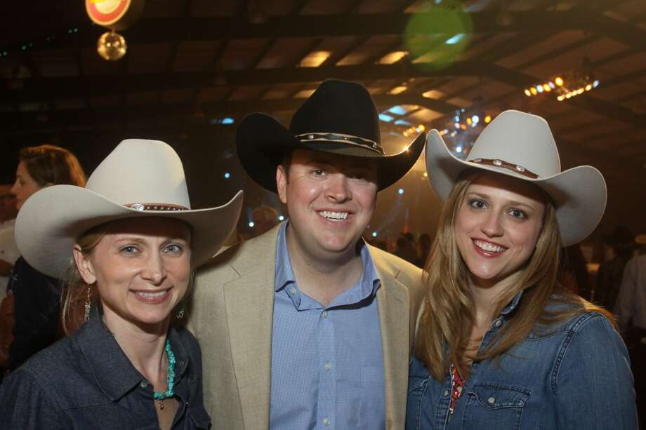 Ashley Irwin, from left, with Ryan and Alison McKenny at the Cattle Barons Ball.