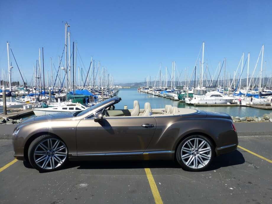 Top down, the Bentley is still pretty quiet. It also has a removable wind blocker that fits over the rear seats.