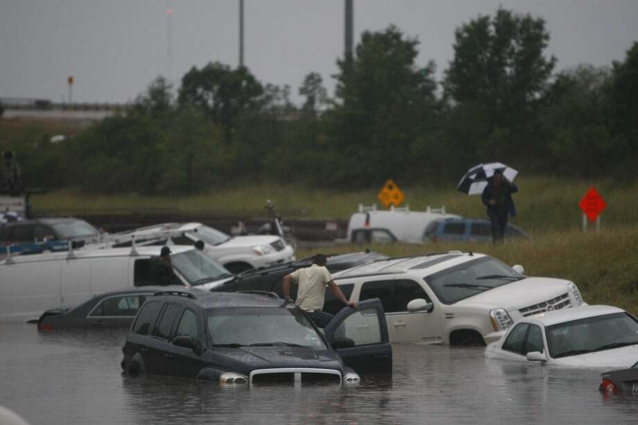 Cars in the flooded highway.