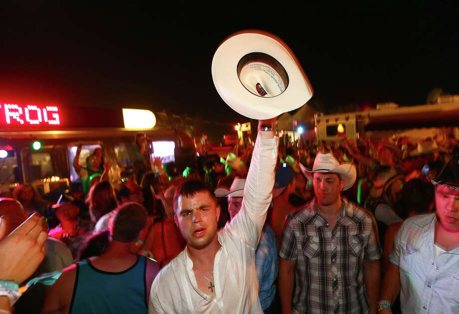 INDIO, CA - APRIL 27:  Festival goers party during 2013 Stagecoach: California's Country Music Festival held at The Empire Polo Club on April 27, 2013 in Indio, California. Photo: Christopher Polk / 2013 Getty Images