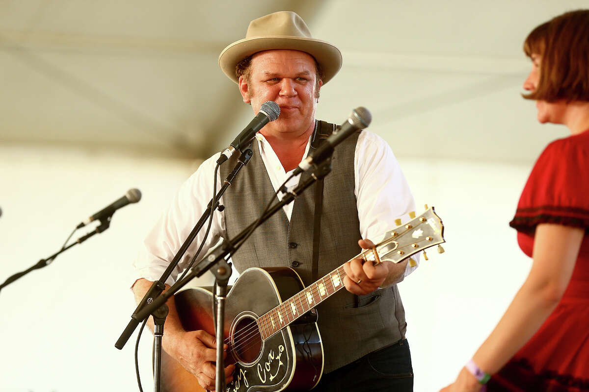 INDIO, CA - APRIL 28: John C. Reilly and Becky Stark perform onstage during 2013 Stagecoach: California's Country Music Festival held at The Empire Polo Club on April 28, 2013 in Indio, California.