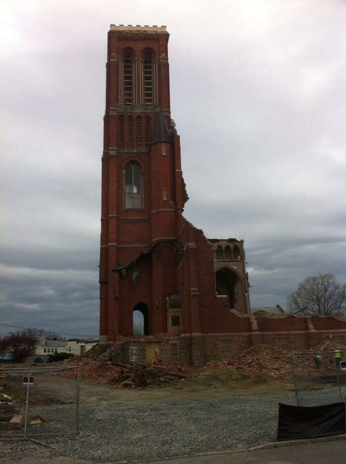 Only the tower and a portion of the west wall are left of the former St. Patrick's Church in Watervliet on Monday, April 29, 2013. (Kenneth C. Crowe II/Times Union)