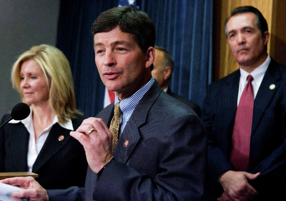 Chairman of of  Republican Study Group Rep. Jeb Hensarling, R-Texas, center, with Rep. Marsha Blackburn, R-Tenn., left, and Rep. Trent Franks, R-Ariz., right, speaks during a news conference on Capitol Hill Monday, Sept. 29, 2008, in Washington. Photo: Manuel Balce Ceneta, AP / AP