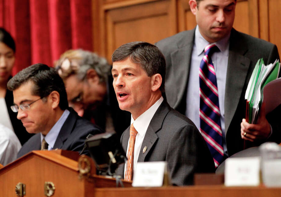 "Rep. Jeb Hensarling, R-Texas, center, joined by Rep. Xavier Becerra, D-Calif., left, opens the first meeting of the Joint Select Committee on Deficit Reduction, often called the ""supercommittee"", on Capitol Hill in Washington, Thursday, Sept. 8, 2011.  Made up of six Republican and six Democratic members of Congress, the panel is charged with finding, by Thanksgiving, $1.5 trillion in savings over the next decade.  (AP Photo/J. Scott Applewhite) Photo: J. Scott Applewhite, Associated Press / AP"