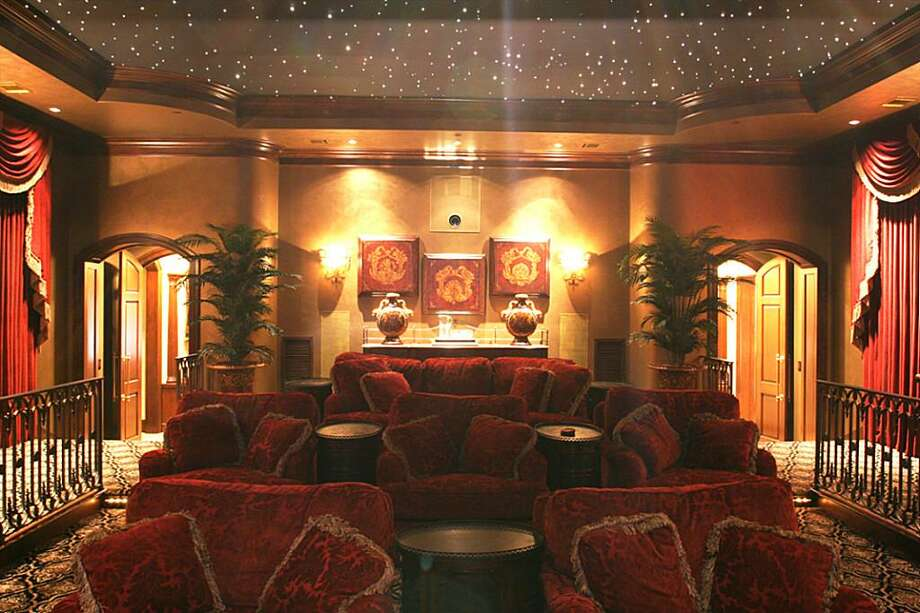 "This breath-taking room has glazed gold walls, working ""theater red"" velvet draperies and sitting of unparalleled comfort. Fiber optic lights in the ceiling creates the stars. Photo: HAR.com"