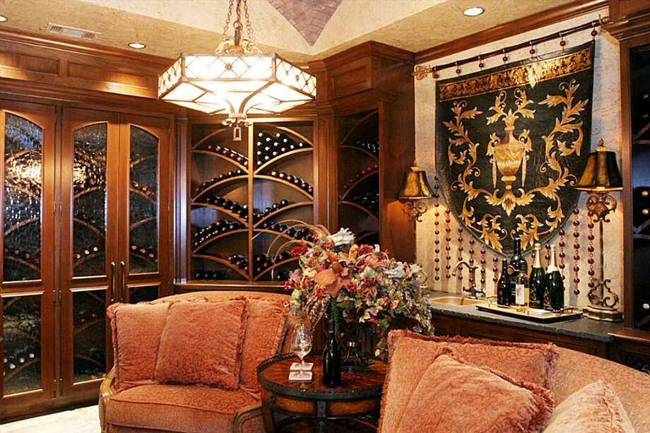 The Old World Charm shows in the Wine Room with its polished hand rubbed woods and barrel ceiling . Photo: HAR.com