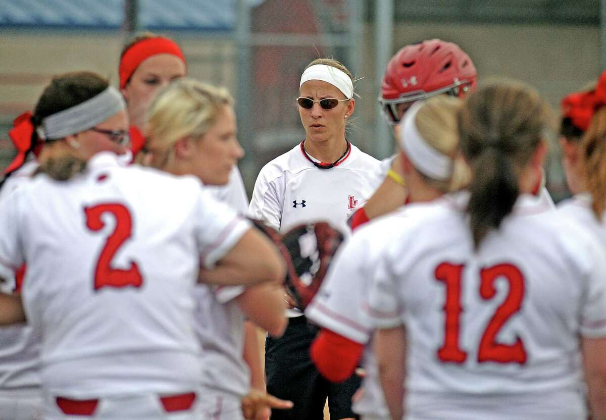 Head coach Holly Bruder joins the team on a pep talk before heading to bat during the Lamar University Lady Cardinals softball game against Texas Souther Lady Tigers on Wednesday, April 17, 2013, at Ford Park. Photo taken: Randy Edwards/The Enterprise