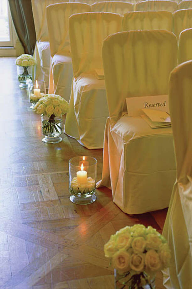 In: Bows and candles down the aisle Photo: Francesca Yorke, Getty Images / (c) Francesca Yorke