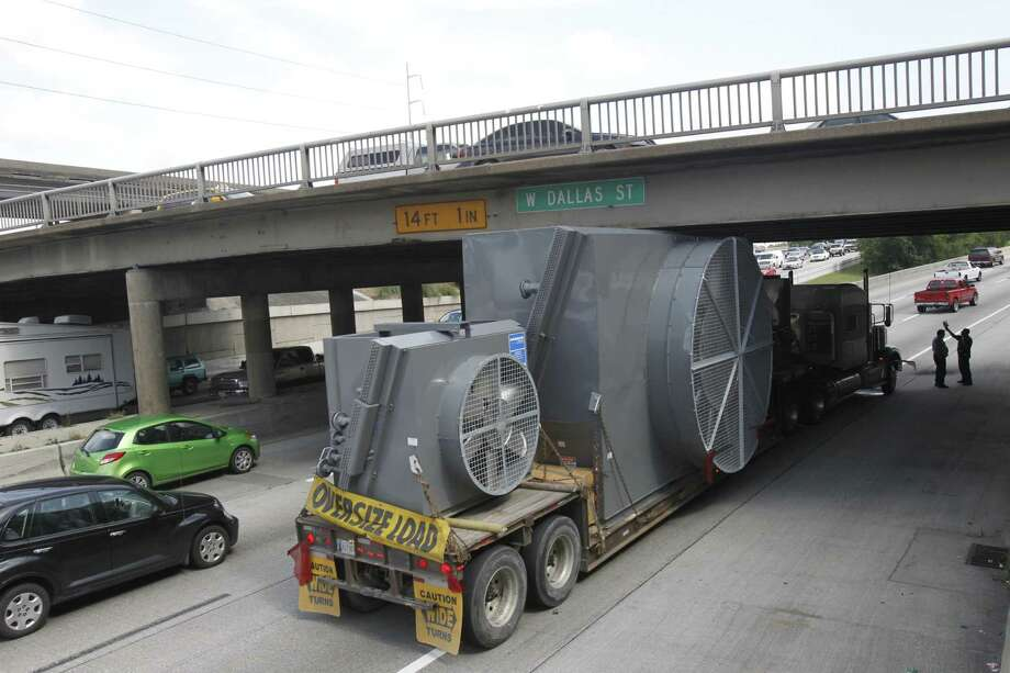 Emergency crews were working to dislodge a trailer that became wedged under the West Dallas overpass on Interstate 45.  Photo: Houston Chronicle