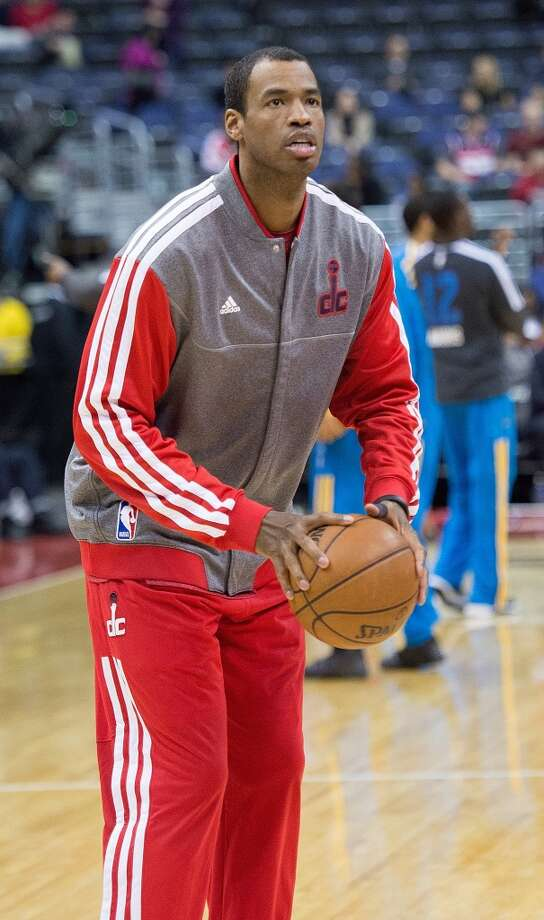 Washington Wizards center Jason Collins (98) warms up before their game against the New Orleans Hornets at the Verizon Center in Washington, D.C., March 15, 2013.