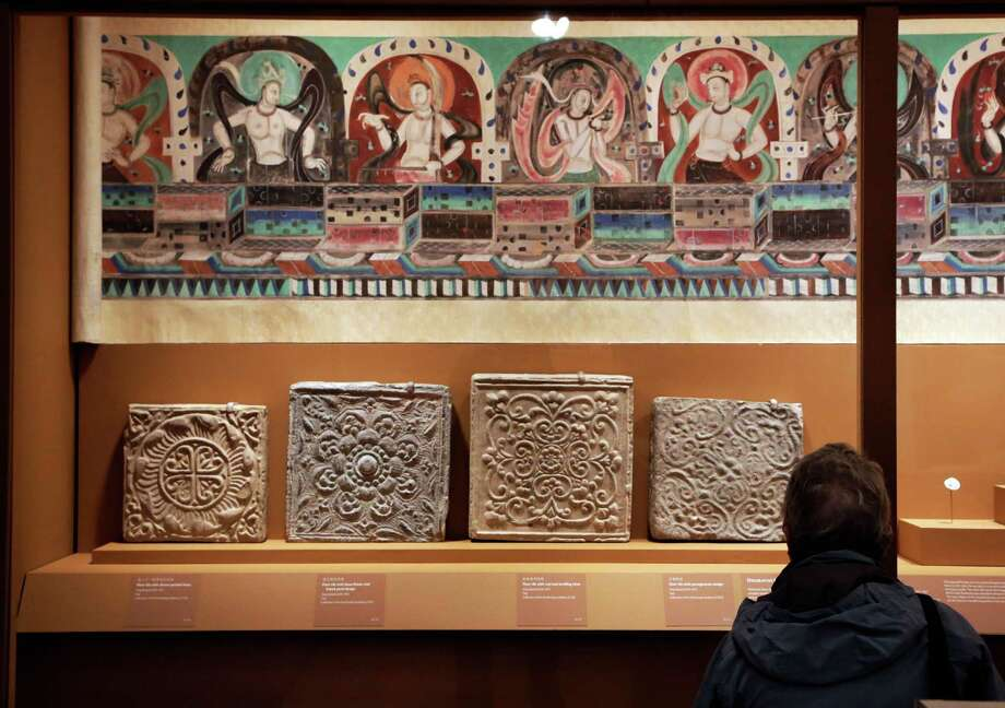 "Decorative floor tiles, and ""Celestial Music"" from Mogao Cave 288, are displayed in ""Dunhuang: Buddhist Art at the Gateway of the Silk Road,"" at the China Institute, in New York,  Tuesday, April 24, 2013. Photo: Richard Drew, AP / AP"