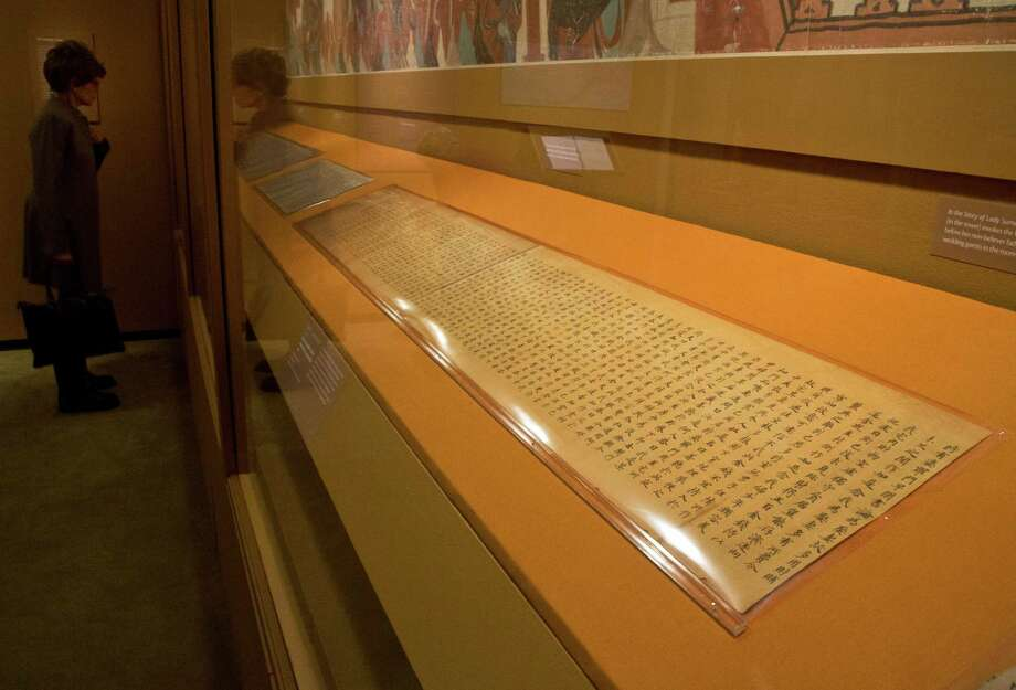 "A handwritten Buddhist scripture, from the Tang Dynasty, 618-907 AD, is displayed in ""Dunhuang: Buddhist Art at the Gateway of the Silk Road,"" at the China Institute, in New York,  Tuesday, April 24, 2013. Photo: Richard Drew, AP / AP"
