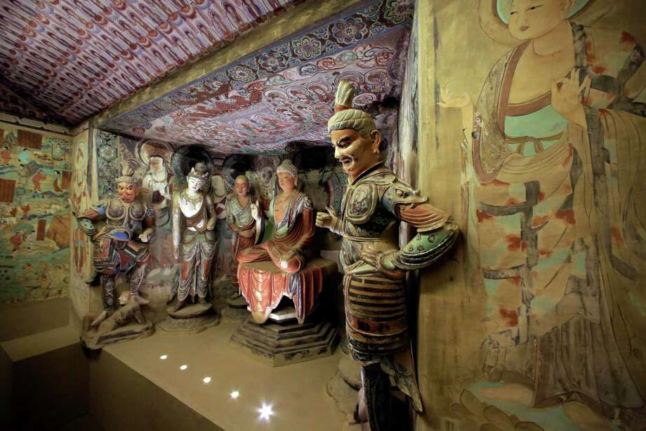 "A full scale replica cave from the 8th century that contains the Bodhisattva of the Mogao Caves is presented in ""Dunhuang: Buddhist Art at the Gateway of the Silk Road,"" at the China Institute, in New York,  Tuesday, April 24, 2013. Photo: Richard Drew, AP / AP"