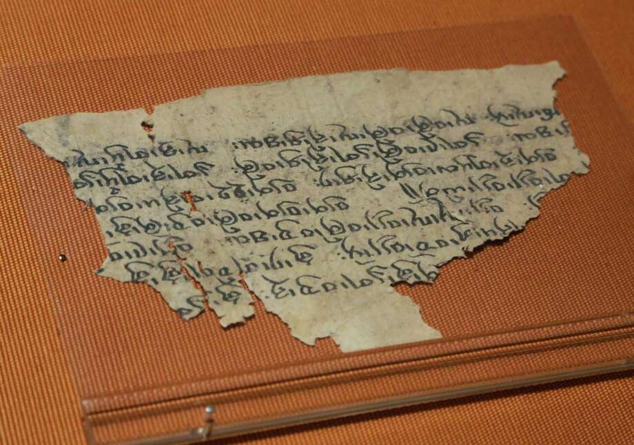 "A fragment of a document on mathematics, written in Tibetan, from the Yuan Dynasty, 1271-1368 AD, is displayed in ""Dunhuang: Buddhist Art at the Gateway of the Silk Road,"" at the China Institute, in New York,  Tuesday, April 24, 2013. Photo: Richard Drew, AP / AP"