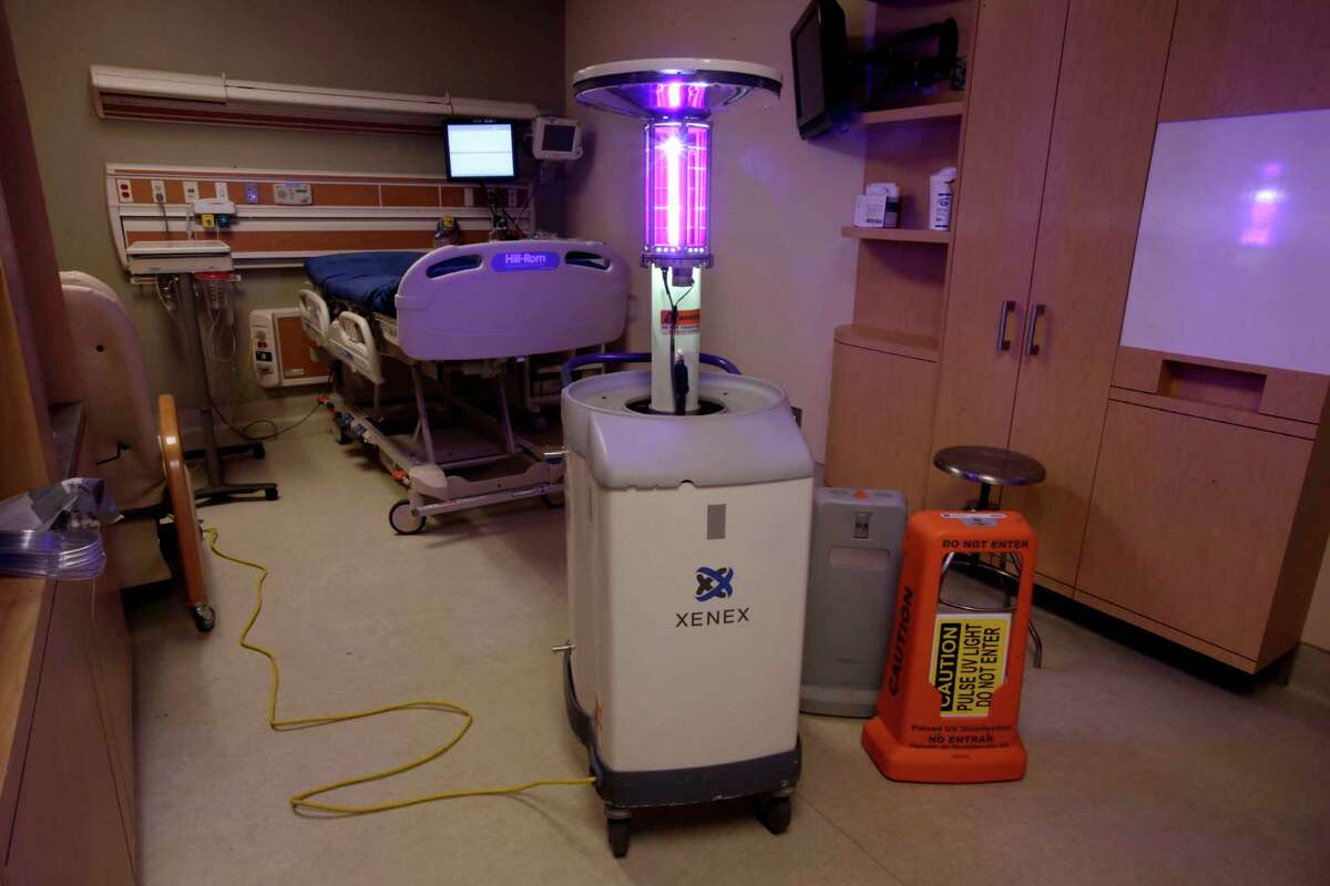 Using ultraviolet light, a machine disinfects a hospital room at the Westchester Medical Center in Valhalla, N.Y., Wednesday, March 20, 2013.