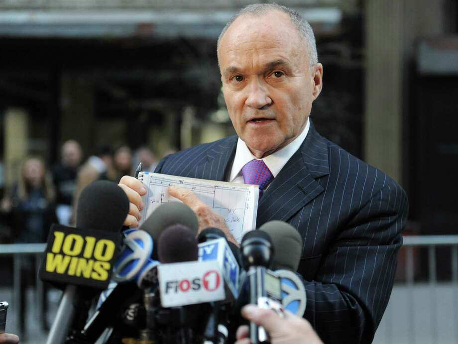 Police Commissioner Ray Kelly uses a sketch drawing to show where piece of a plane was found, Friday, April 26, 2013, in New York. The part, apparently from one of the commercial airliners destroyed on September 11, 2001, has been discovered wedged between the rear of 51 Park Place and the rear of the building behind it, 50 Murray Street, in lower Manhattan. Photo: Louis Lanzano, AP / FR77522 AP