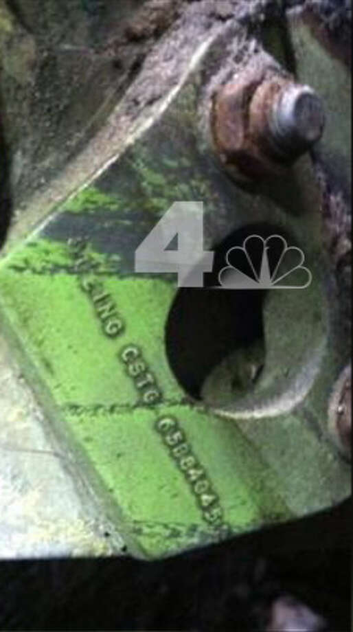 In this April 26, 2013 photo provided by WNBC-TV in New York, a section of wreckage bearing a Boeing serial number is shown. It was found wedged in between two New York City buildings not far from the World Trade Center construction site. It' believed to be from one of the airliners that were crashed into the World Trade Center in the terrorist attacks of September 11, 2001. (AP Photo/WNBC-TV) MANDATORY CREDIT   NO SALES Photo: AP / WNBC-TV