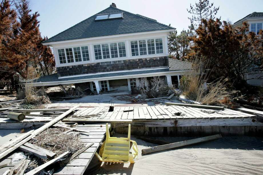 A home rests along Barnegat Bay, Thursday, April 25, 2013, in Mantoloking, N.J., after it was severely damaged last October by Superstorm Sandy. Six months after Sandy devastated the Jersey shore and New York City and pounded coastal areas of New England, the region is dealing with a slow and frustrating, yet often hopeful, recovery. Photo: Mel Evans, AP / AP