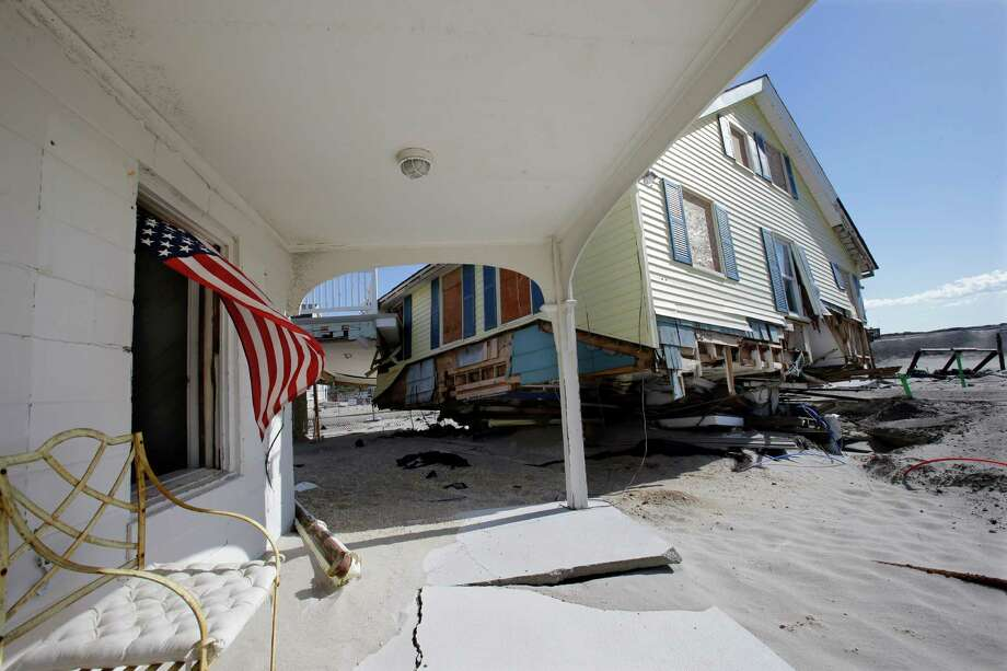 Homes destroyed last October by Superstorm Sandy are seen Thursday, April 25, 2013, in Brick, N.J. Six months after Sandy devastated the Jersey shore and New York City and pounded coastal areas of New England, the region is dealing with a slow and frustrating, yet often hopeful, recovery. Photo: Mel Evans, AP / AP
