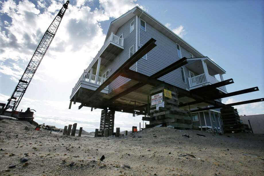 An oceanfront home is being raised to protect from flooding in Ortley Beach, N.J., Thursday, April 25, 2013. Six months after Suprestorm Sandy devastated the Jersey shore and New York City and pounded coastal areas of New England, the region is dealing with a slow and frustrating, yet often hopeful, recovery. Photo: Mel Evans, AP / AP