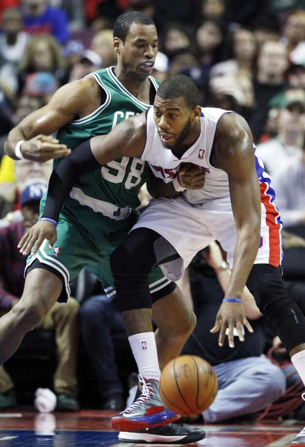 In this Jan. 20, 2013 file photo, then-Boston Celtics center Jason Collins (98) guards Detroit Pistons center Greg Monroe, right, in the second half of an NBA basketball game in Auburn Hills, Mich. Jason Collins has become the first male professional athlete in the major four American sports leagues to come out as gay.