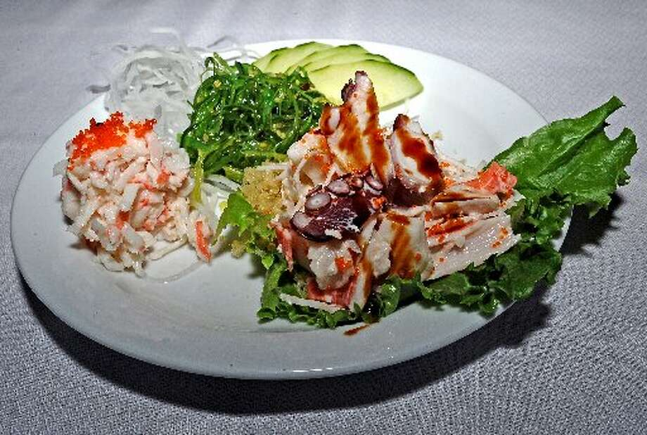 Seaweed salad, marinated crab, and special salad served at Sushi 101at Tokyo. Randy Edwards/cat5