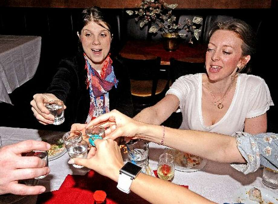 Sheena McCrary, left, and Summer Lydick, right, drink sake during Sushi 101 at Tokyo. Randy Edwards/cat5