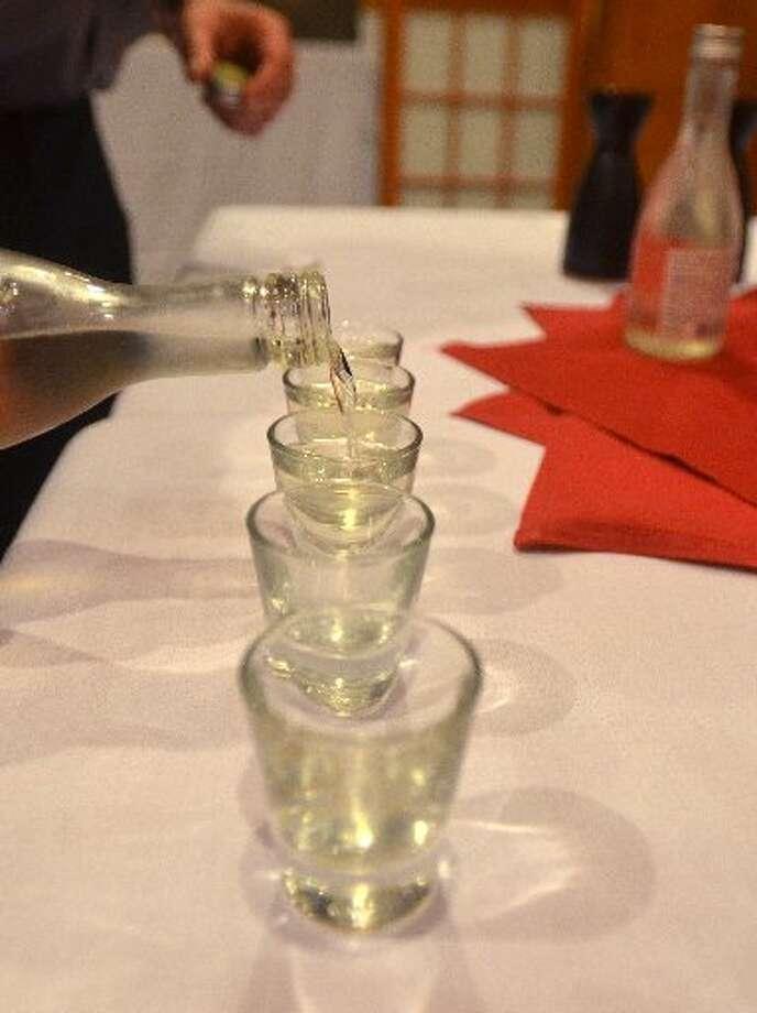 Shaggy Jordan pours sake during Sushi 101. Beth Rankin/cat5