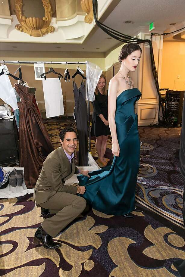 Zac Posen adjusts a design before a model takes to the runway at the San Francisco BalletAuxiliaryFashion Show on April 26, 2013. Photo: Drew Altizer Photography