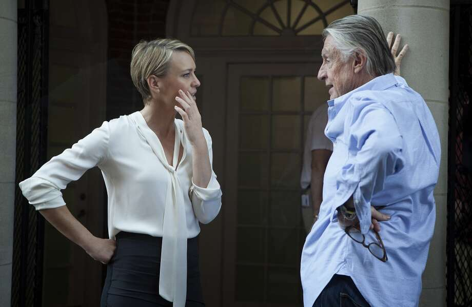 'House of Cards':Robin Wright as Claire Underwood, seen here with director Joel Schumacher, dresses in office-appropriate looks this  Netflix series.