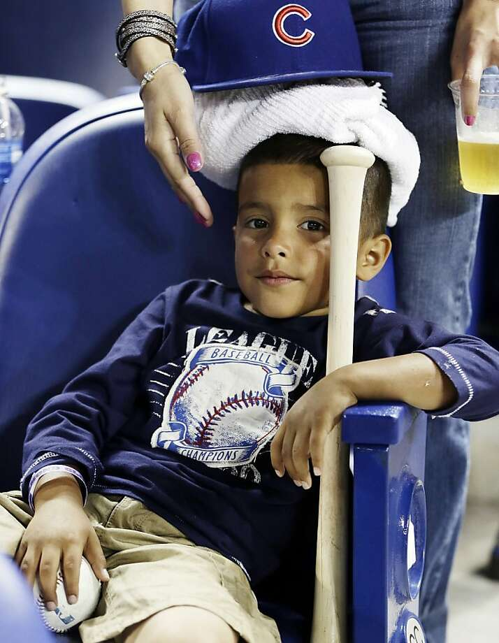 Cubs baseball gives him a headache:After being hit in the head by a Cubs line-drive foul ball, Nikolai Reyes sits   with a towel full of ice on his head and parting gifts - the ball, a bat and a Cubs cap - during the ninth inning   of the Chicago-Miami in Miami. Photo: J Pat Carter, Associated Press