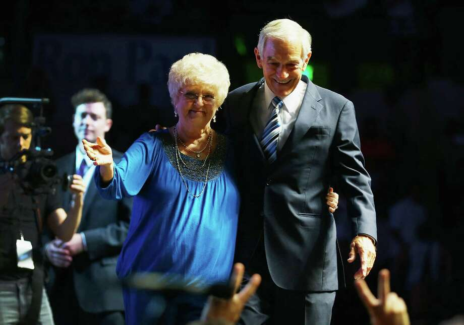 TAMPA, FL - AUGUST 26:  Former Republican presidential candidate U.S. Rep. Ron Paul (R-TX) and his wife, Carol Paul, stand together after he spoke at a rally in the Sun Dome at the University of South Florida on August 26, 2012 in Tampa, Florida.   The rally was being held on the eve of the start of the Republican's nominating convention which is scheduled to convene on August 27 and will hold its first session on August 28 as Tropical Storm Isaac threatens disruptions due to its proximity to the Florida.  (Photo by Joe Raedle/Getty Images) Photo: Joe Raedle, Getty Images / 2012 Getty Images