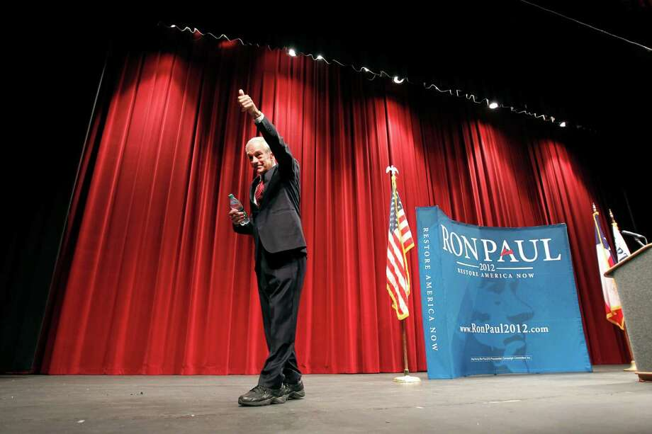 Ron Paul gives a thumbs up to his supporters while leaving the stage after holding a town hall meeting at Will Rogers Memorial Center in Fort Worth, Texas, on Wednesday, April 11, 2012. Photo: Lara Solt, The Associated Press / The Dallas Morning News