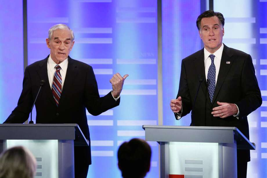 Ron Paul and Mitt Romney participate in the Republican Presidential Debate at Saint Anselm College on Jan. 7, 2012 in Manchester, N.H. Photo: Win McNamee, Getty Images / 2012 Getty Images