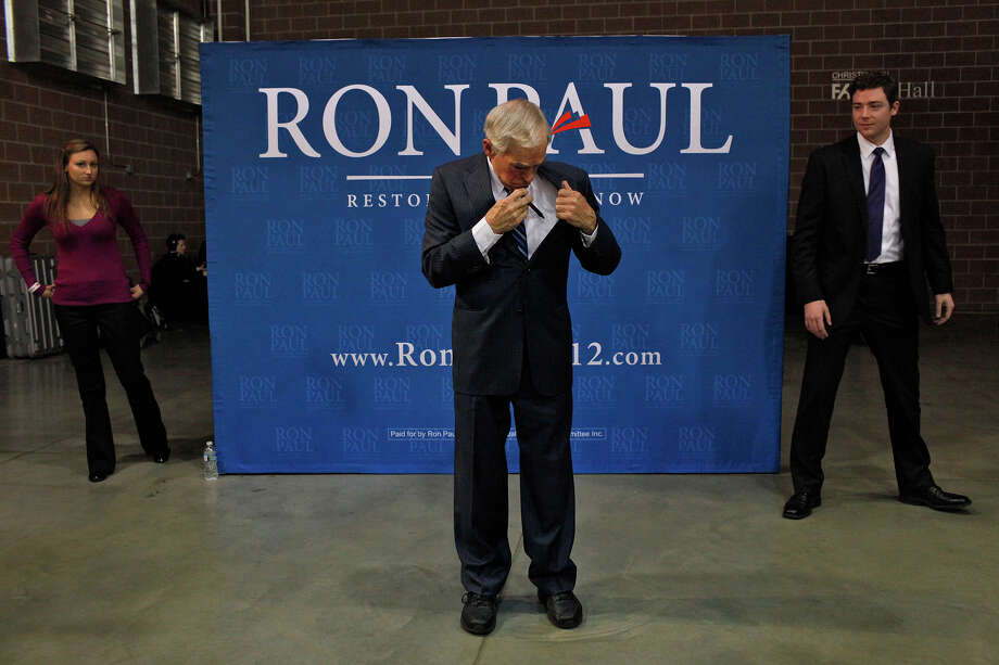 "Ron Paul gets ready to pose for photos with supporters after speaking at his ""Salute to Veterans"" rally at the Iowa State Fairgrounds in Des Moines, IA on Wednesday, Dec. 28, 2011. Photo: Lisa Krantz, San Antonio Express-News / SAN ANTONIO EXPRESS-NEWS"