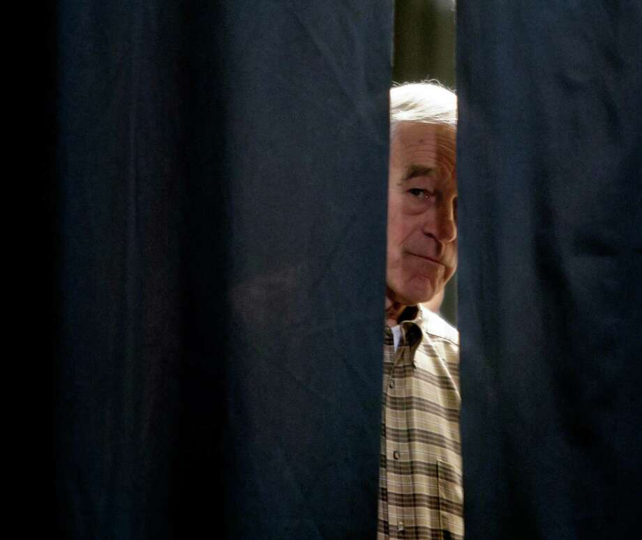 Republican presidential candidate Ron Paul waits to be introduced before a crowd, Saturday, Feb. 18, 2012, in Boise, Idaho. Photo: Darin Oswald, Associated Press / Idaho Statesman