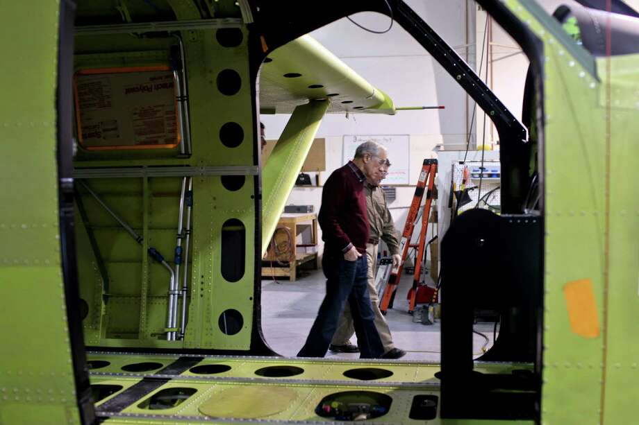 Ron Paul tours the manufacturing facility at Quest Aircraft Company with employee Paul Branham, Monday, March 5, 2012, in Sandpoint, Idaho. Photo: Matt Mills McKnight, Associated Press / FR170429 AP