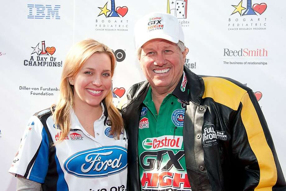 63-year-old John Force is head of the NHRA drag racing's first family. The 15-time champion driver has three daughters (one seen here) and a son-in-law who are drag racers. Photo: Amanda Edwards, Getty Images