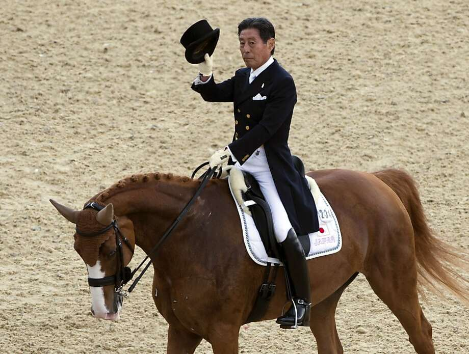 Japan's Hiroshi Hoketsu on Whisper salutes spectators after competing in the Dressage preliminaries of the London 2012 Olympics. Hoketsu is 72 years old. Photo: John MacDougall, AFP/Getty Images