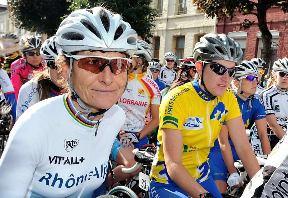 French cyclist Jeannie Longo (left) is 54 and one of the greatest female cyclists in history. Longo is a 59-time French champion. Photo: Philippe Huguen, AFP/Getty Images