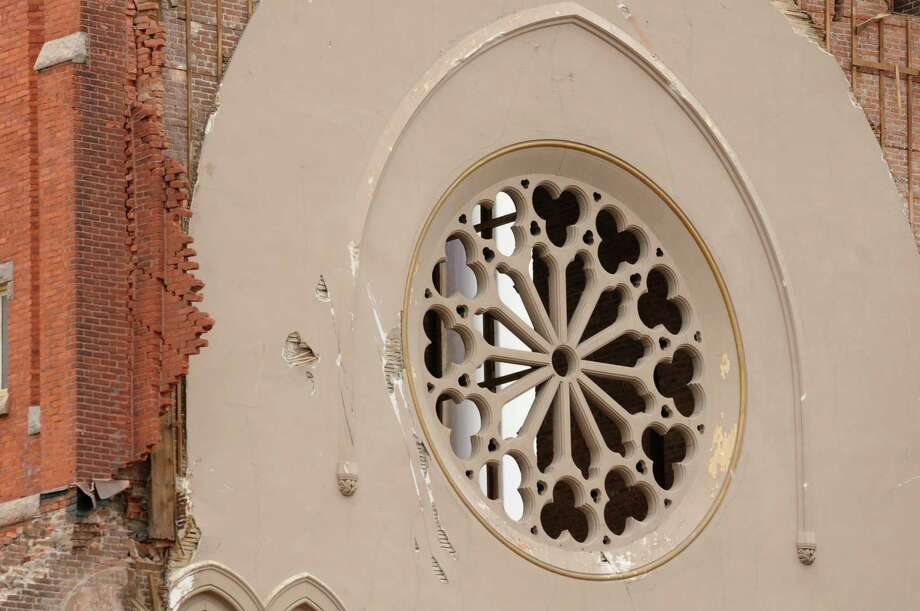 The rose window remains as demolition continues at the former St. Patrick's Church on Monday, April 29, 2013, in Watervliet, N.Y.  (Lori Van Buren / Times Union) Photo: Lori Van Buren / 10022173A