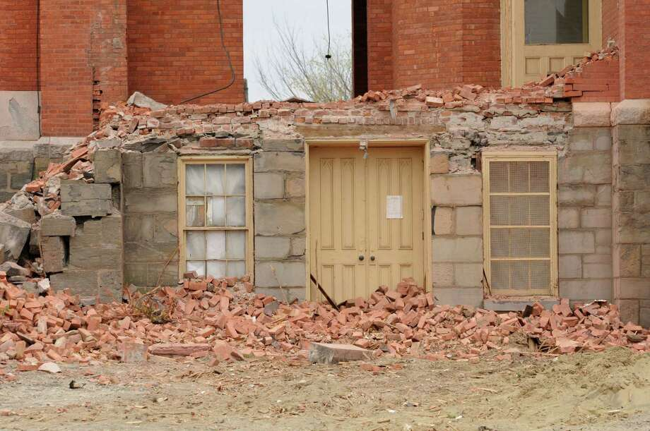 A side door and windows stand among rubble as demolition continues at the former St. Patrick's Church on Monday, April 29, 2013, in Watervliet, N.Y.  (Lori Van Buren / Times Union) Photo: Lori Van Buren / 10022173A