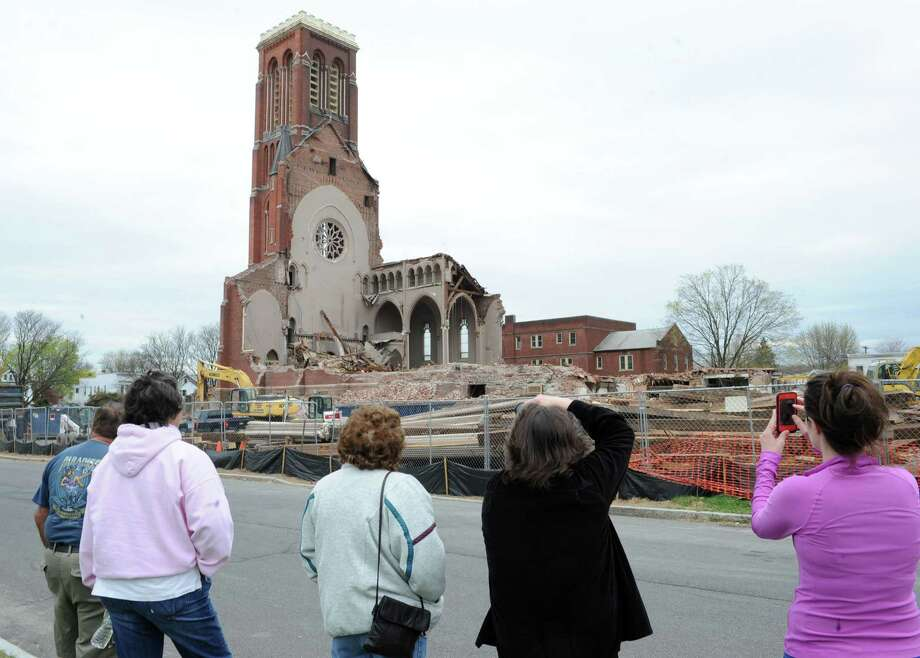 Local spectators watch as demolition continues at the former St. Patrick's Church on Monday, April 29, 2013, in Watervliet, N.Y.  (Lori Van Buren / Times Union) Photo: Lori Van Buren / 10022173A