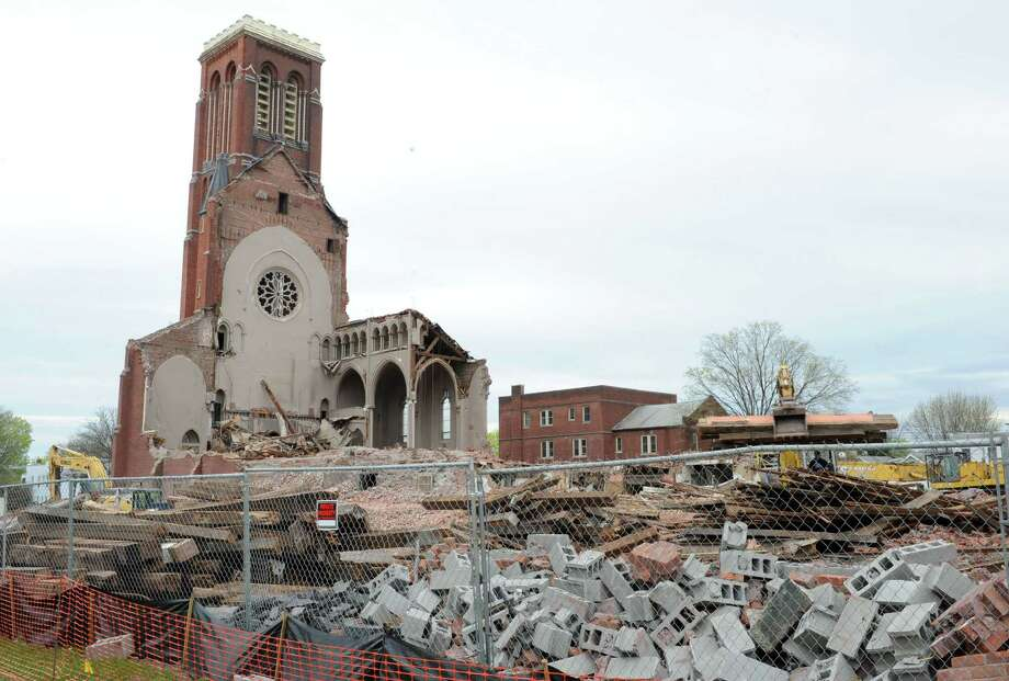 Demolition continues at the former St. Patrick's Church on Monday, April 29, 2013, in Watervliet, N.Y.  (Lori Van Buren / Times Union) Photo: Lori Van Buren / 10022173A