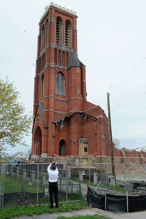 The facade and tower remain as demolition continues at the former St. Patrick's Church on Monday, April 29, 2013, in Watervliet, N.Y.  (Lori Van Buren / Times Union) Photo: Lori Van Buren / 10022173A