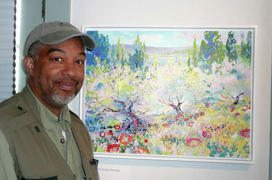 "Artist/Art Instructor Dmitri Wright, of Greenwich, is holding a one man show, ""Impressions of Light,"" at the Weir Farm National Historic Site, in Wilton. Among the works on display is Wright's Impressionist look at olive trees, ""Splendors of the Lovely,"" which he painted while in Tuscany. Photo: Anne W. Semmes"