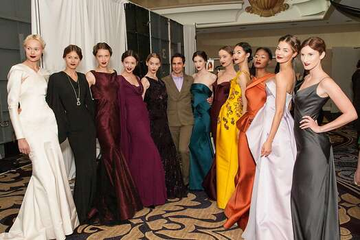 """April 26: Designer Zac Posen (center) headlines the San Francisco Ballet Auxiliary's annual fashion show fundraising luncheon at the Fairmont Hotel in S.F., bringing anatomical, architectural, glamorous gowns to the runway. He's influenced by body mechanics, and notes: """"It's important for women to embrace themselves instead of trying to hide their bodies. It never works."""" Photo: Drew Altizer Photography, Laura Morton For Drew Altizer Ph"""