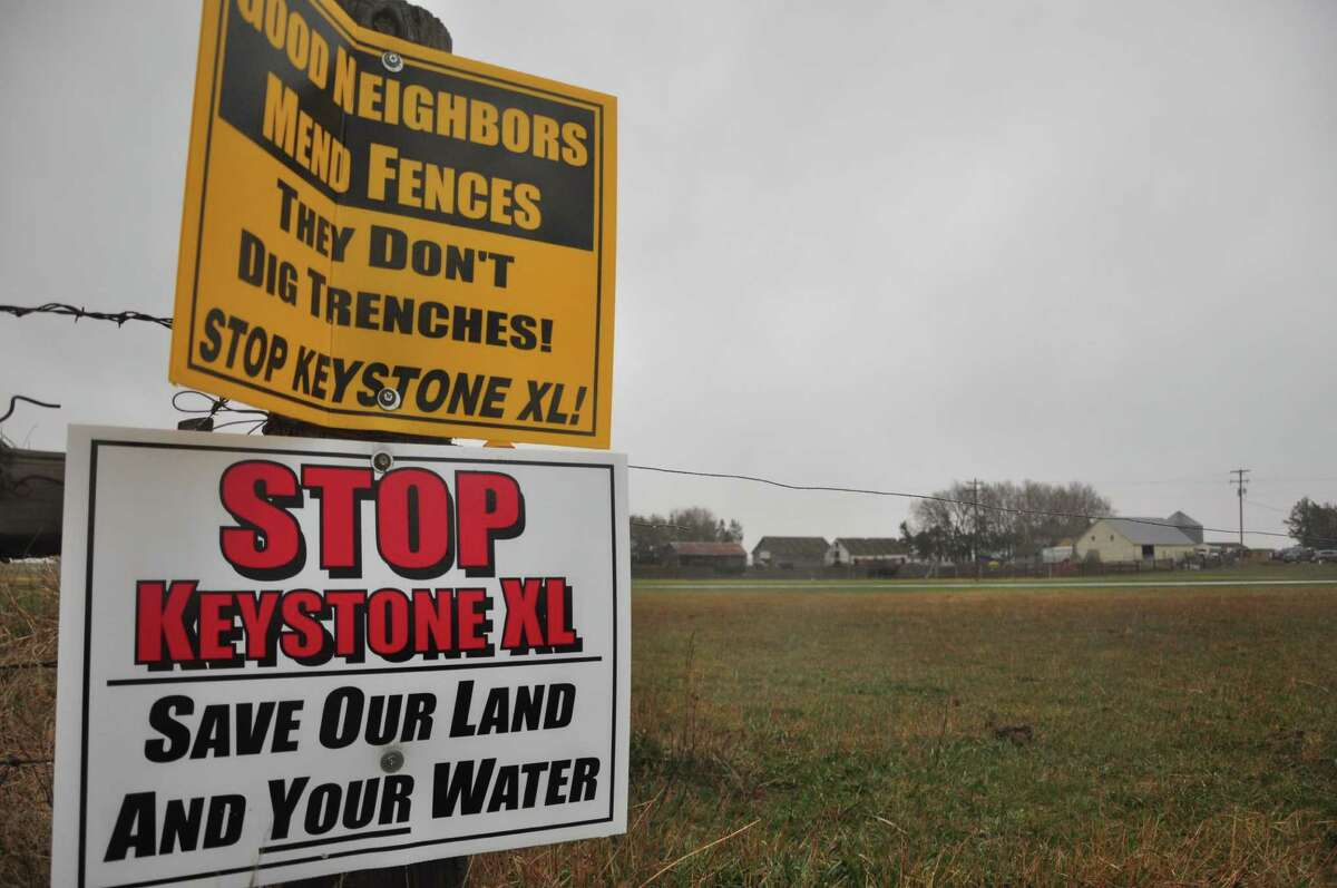 Signs attached to a fence on the property of Jim Tarnick, a farmer opposed to the controversial Keystone XL pipeline, are pictured April 17, 2013 in Fullerton, Nebraska. The fence is on the exact route the pipeline would be on his land. A lengthy battle over the controversial Keystone XL pipeline, which aims to funnel oil from Canada's tar sands to coastal Texas, heads to the most hotly contested area along the route on April 18, 2013. Hundreds of people are expected at a public hearing in Nebraska's environmentally sensitive Sand Hills as the US State Department prepares its recommendation on whether to approve the $5.3 billion project. AFP PHOTO / Guillaume MEYERGuillaume Meyer/AFP/Getty Images