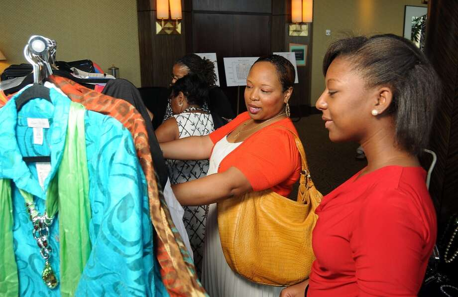 Courtney Wills and Leslie Slider browse the fashions for sale at the Brentwood Baptist Church's annual luncheon and fashion show at the Hilton Americas Hotel Sunday April 28, 2013.(Dave Rossman photo)