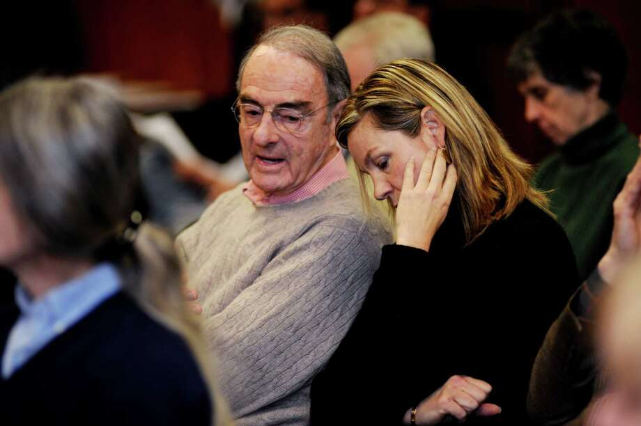 Peter Malkin speaks with Gretchen Biggs at a Greenwich Board of Selectmen hearing about regulating leaf blowers in Greenwich on Thursday, March 1, 2012. Malkin and his son Anthony want to publicly sell shares in their real estate holdings, including the Empire State Building. Some minority owners of the iconic New York structure are fighting their plan in court. Photo: Helen Neafsey / Greenwich Time
